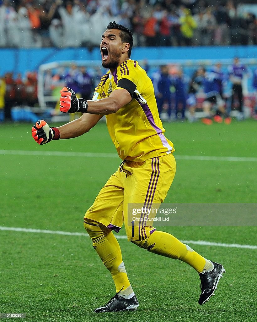 Sergio Romero of Argentina celebrates after saving the penalty of Wesley Sneijder of the Netherlands during the 2014 FIFA World Cup Brazil Semi Final match between Netherlands and Argentina at Arena de Sao Paulo on July 09, 2014 in Sao Paulo, Brazil.