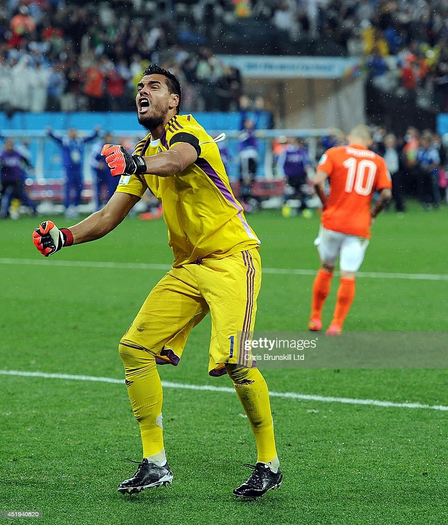 <a gi-track='captionPersonalityLinkClicked' href=/galleries/search?phrase=Sergio+Romero&family=editorial&specificpeople=4100804 ng-click='$event.stopPropagation()'>Sergio Romero</a> of Argentina celebrates after saving the penalty of <a gi-track='captionPersonalityLinkClicked' href=/galleries/search?phrase=Wesley+Sneijder&family=editorial&specificpeople=538145 ng-click='$event.stopPropagation()'>Wesley Sneijder</a> of the Netherlands during the 2014 FIFA World Cup Brazil Semi Final match between Netherlands and Argentina at Arena de Sao Paulo on July 09, 2014 in Sao Paulo, Brazil.