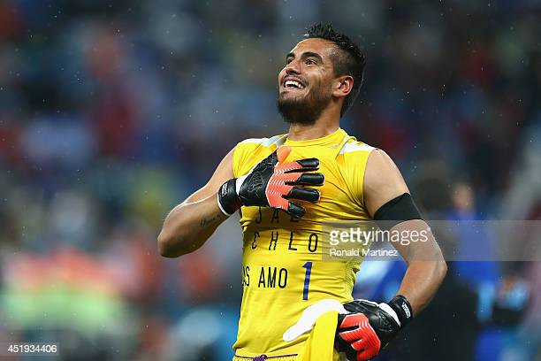 Sergio Romero of Argentina celebrates defeating the Netherlands in a shootout during the 2014 FIFA World Cup Brazil Semi Final match between the...