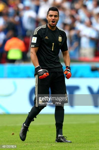 Sergio Romero of Argentina celebrates his team's second goal by Lionel Messi during the 2014 FIFA World Cup Brazil Group F match between Nigeria and...