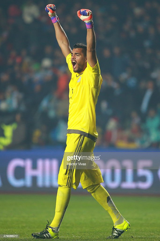 <a gi-track='captionPersonalityLinkClicked' href=/galleries/search?phrase=Sergio+Romero&family=editorial&specificpeople=4100804 ng-click='$event.stopPropagation()'>Sergio Romero</a> of Argentina celebrates the opening goal of his team scored by Marcos Rojo of Argentina (NOT IN FRAME) during the 2015 Copa America Chile Semi Final match between Argentina and Paraguay at Ester Roa Rebolledo Stadium on June 30, 2015 in Concepcion, Chile.