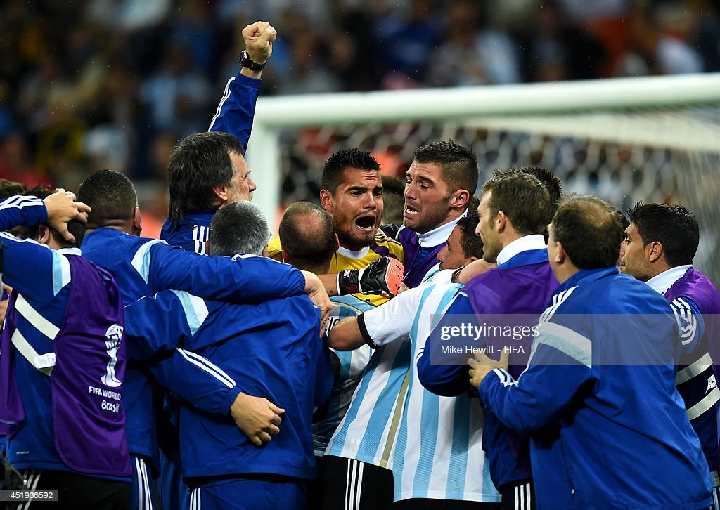 Sergio Romero (C) of Argentina celebrates the win on penalties after the 2014 FIFA World Cup Brazil Semi Final match between Netherlands and Argentina at Arena de Sao Paulo on July 9, 2014 in Sao Paulo, Brazil.