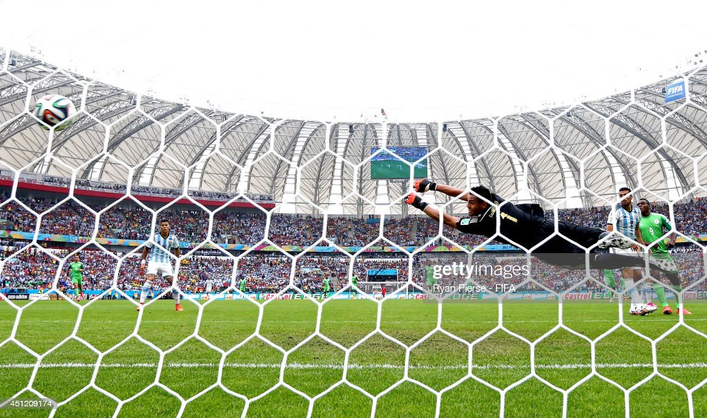 <a gi-track='captionPersonalityLinkClicked' href=/galleries/search?phrase=Sergio+Romero&family=editorial&specificpeople=4100804 ng-click='$event.stopPropagation()'>Sergio Romero</a> of Argentina fails to stop the Nigeria's first goal scored by Ahmed Musa (not pictured) during the 2014 FIFA World Cup Brazil Group F match between Nigeria and Argentina at Estadio Beira-Rio on June 25, 2014 in Porto Alegre, Brazil.
