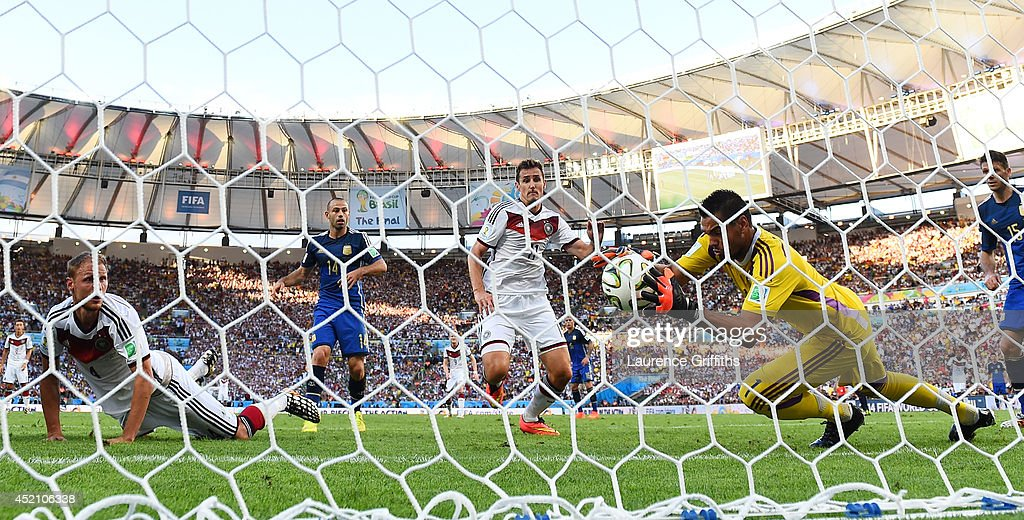 Sergio Romero of Argentina makes a save at an attempt at goal by Benedikt Hoewedes of Germany during the 2014 FIFA World Cup Brazil Final match between Germany and Argentina at Maracana on July 13, 2014 in Rio de Janeiro, Brazil.
