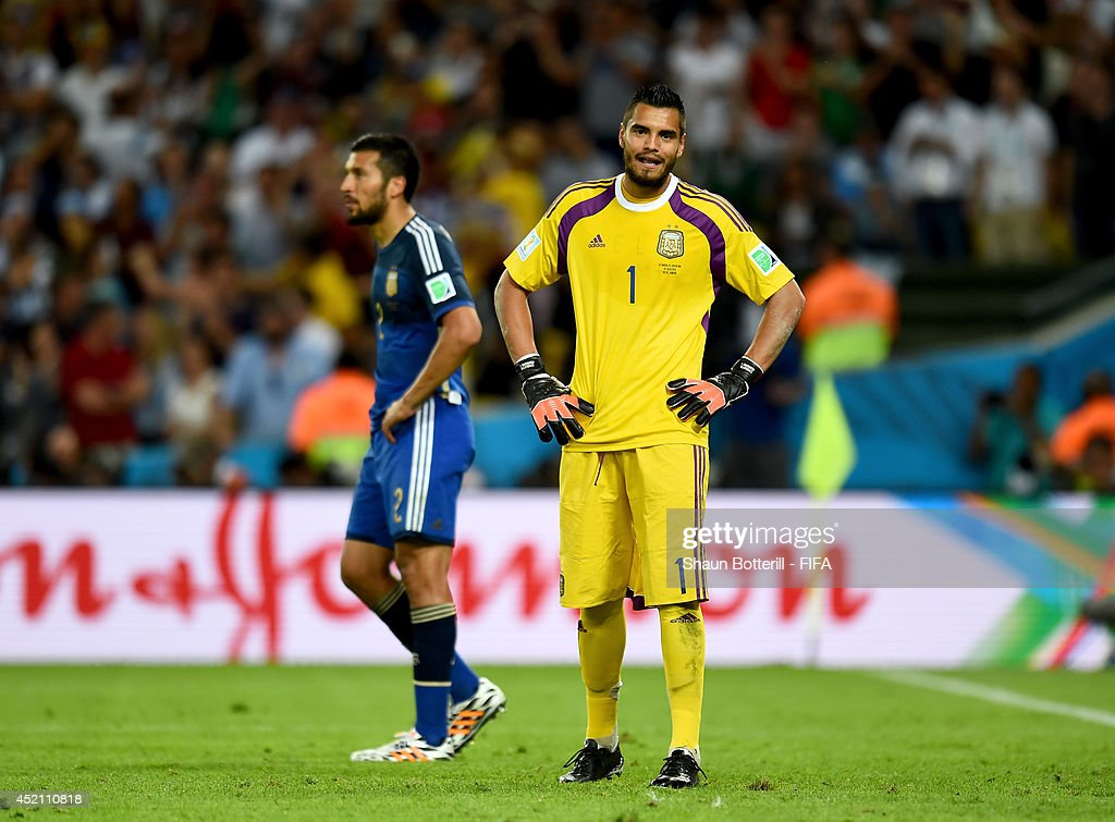 <a gi-track='captionPersonalityLinkClicked' href=/galleries/search?phrase=Sergio+Romero&family=editorial&specificpeople=4100804 ng-click='$event.stopPropagation()'>Sergio Romero</a> of Argentina reacts after conceding the first goal to Germany during the 2014 FIFA World Cup Brazil Final match between Germany and Argentina at Maracana on July 13, 2014 in Rio de Janeiro, Brazil.