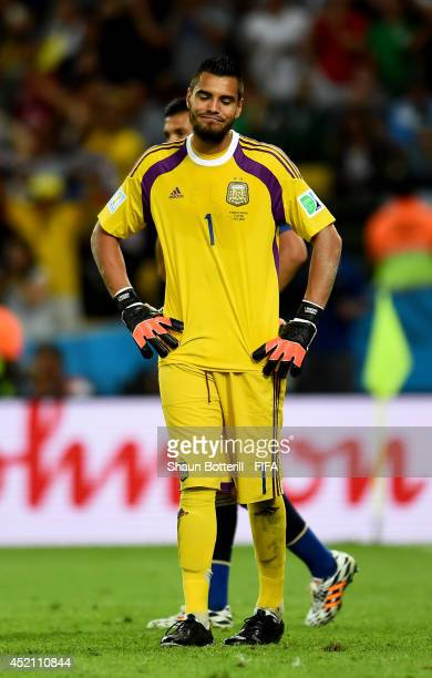 Sergio Romero of Argentina reacts after conceding the first goal to Germany during the 2014 FIFA World Cup Brazil Final match between Germany and...