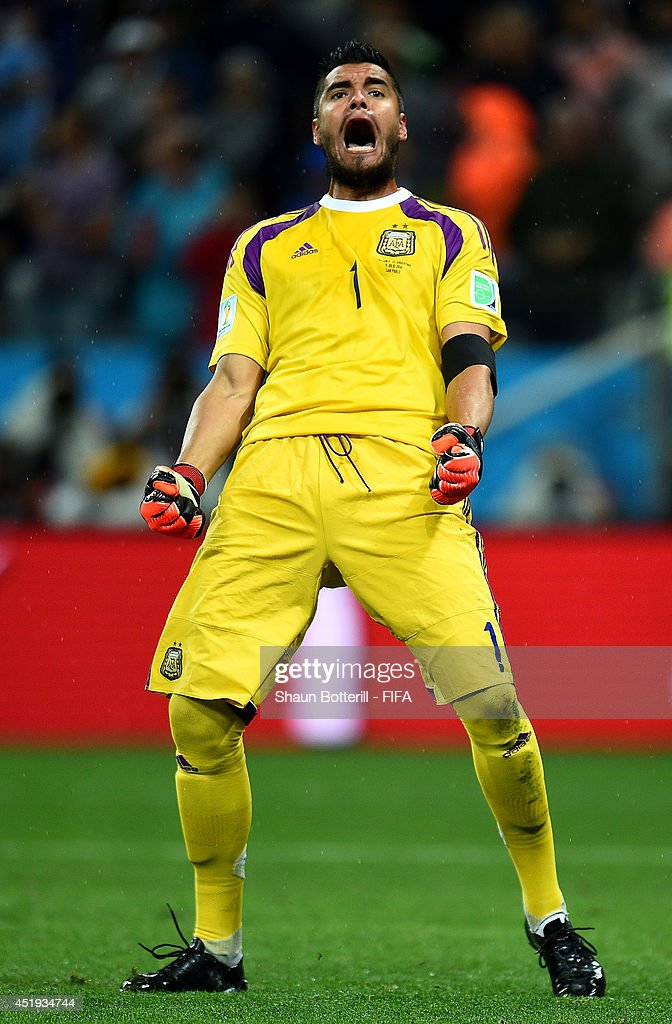 <a gi-track='captionPersonalityLinkClicked' href=/galleries/search?phrase=Sergio+Romero&family=editorial&specificpeople=4100804 ng-click='$event.stopPropagation()'>Sergio Romero</a> of Argentina reacts after saving a penalty by Ron Vlaar of the Netherlands in the penalty shootout during the 2014 FIFA World Cup Brazil Semi Final match between Netherlands and Argentina at Arena de Sao Paulo on July 9, 2014 in Sao Paulo, Brazil.