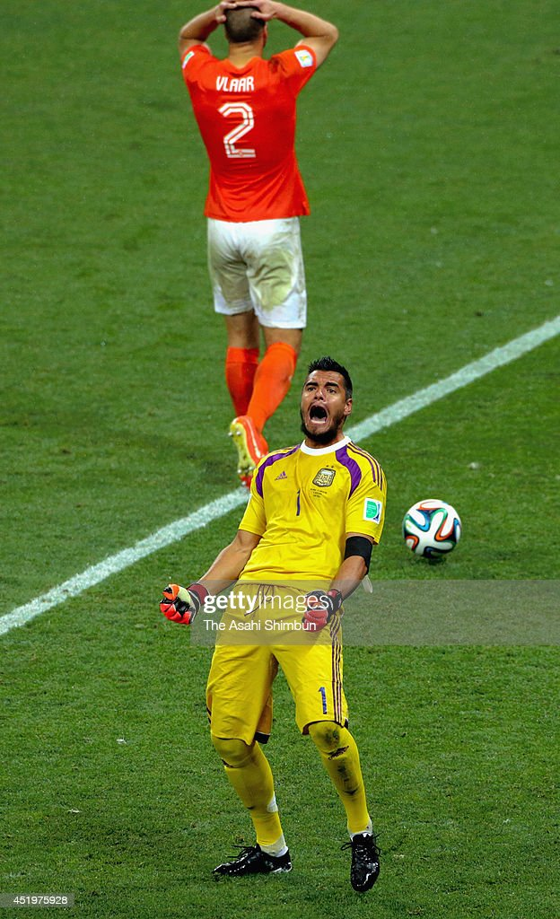 Sergio Romero of Argentina reacts after stopping a penalty by Ron Vlaar of the Netherlands in the penalty shootout during the 2014 FIFA World Cup Brazil Semi Final match between Netherlands and Argentina at Arena de Sao Paulo on July 09, 2014 in Sao Paulo, Brazil.