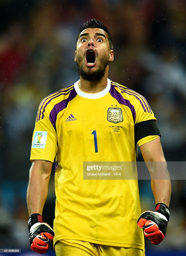 <a gi-track='captionPersonalityLinkClicked' href=/galleries/search?phrase=Sergio+Romero&family=editorial&specificpeople=4100804 ng-click='$event.stopPropagation()'>Sergio Romero</a> of Argentina reacts after stopping the penalty kick by Wesley Sneijder of the Netherlands in the penalty shootout during the 2014 FIFA World Cup Brazil Semi Final match between Netherlands and Argentina at Arena de Sao Paulo on July 9, 2014 in Sao Paulo, Brazil.