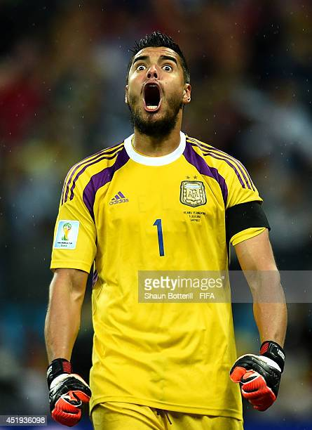 Sergio Romero of Argentina reacts after stopping the penalty kick by Wesley Sneijder of the Netherlands in the penalty shootout during the 2014 FIFA...