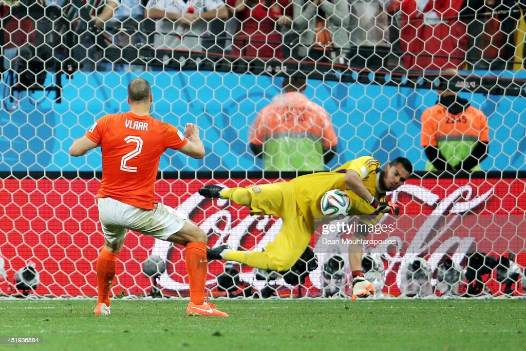 Sergio Romero of Argentina saves the penalty kick of Ron Vlaar of the Netherlands in a shootout during the 2014 FIFA World Cup Brazil Semi Final match between the Netherlands and Argentina at Arena de Sao Paulo on July 9, 2014 in Sao Paulo, Brazil.