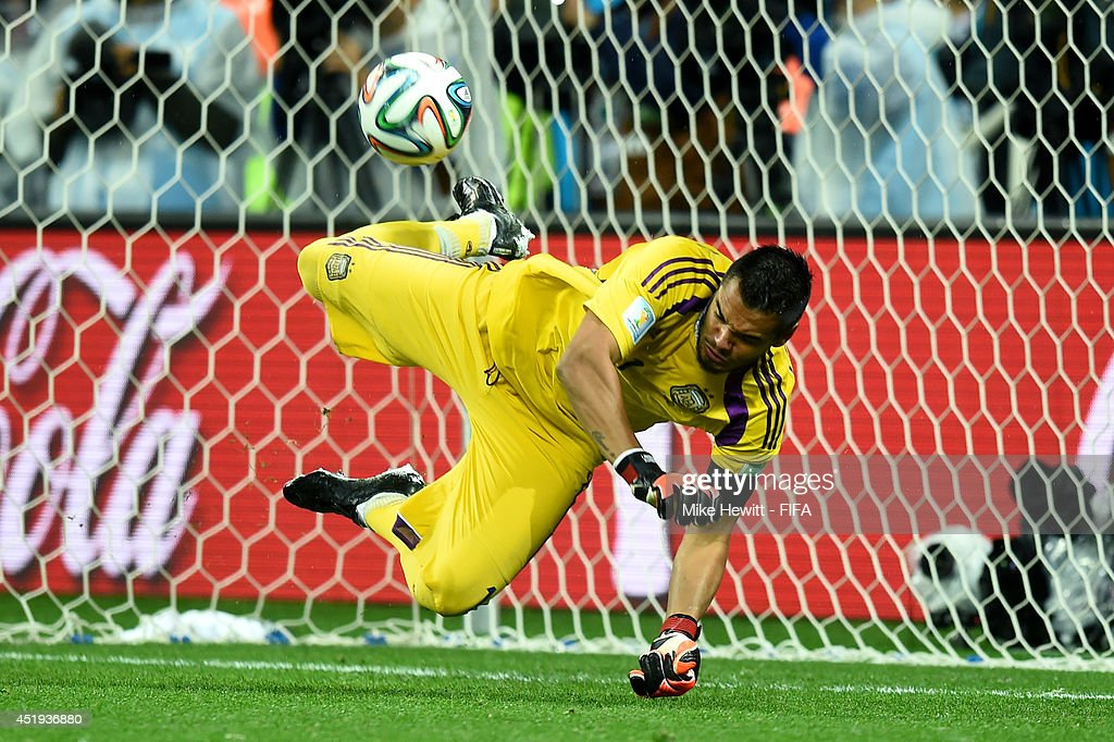 Sergio Romero of Argentina stops the penalty kick by Ron Vlaar of the Netherlands in the penalty shootout during the 2014 FIFA World Cup Brazil Semi Final match between Netherlands and Argentina at Arena de Sao Paulo on July 9, 2014 in Sao Paulo, Brazil.