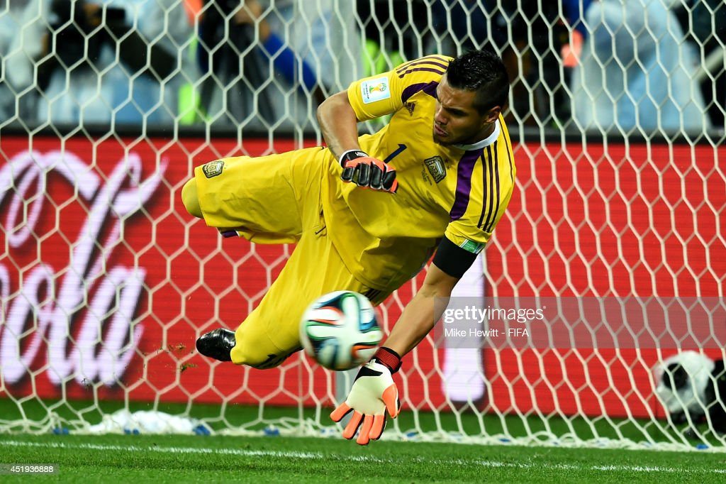 <a gi-track='captionPersonalityLinkClicked' href=/galleries/search?phrase=Sergio+Romero&family=editorial&specificpeople=4100804 ng-click='$event.stopPropagation()'>Sergio Romero</a> of Argentina stops the penalty kick by Ron Vlaar of the Netherlands in the penalty shootout during the 2014 FIFA World Cup Brazil Semi Final match between Netherlands and Argentina at Arena de Sao Paulo on July 9, 2014 in Sao Paulo, Brazil.
