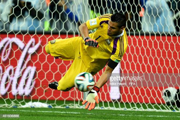 Sergio Romero of Argentina stops the penalty kick by Ron Vlaar of the Netherlands in the penalty shootout during the 2014 FIFA World Cup Brazil Semi...