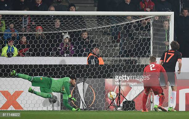 Sergio Romero of Manchester United makes a save a header by Kian Hansen of FC Midtjylland during the UEFA Europa League round of 32 first leg match...