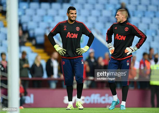 Sergio Romero of Manchester United with Sam Johnstone of Manchester United prior to the Barclays Premier League match between Aston Villa and...