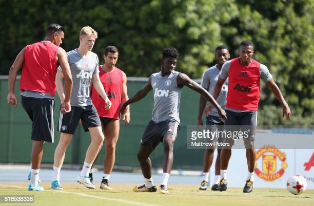 Sergio Romero Scott McTominay Axel Tuanzebe and Antonio Valencia of Manchester United in action during a first team training session as part of their...