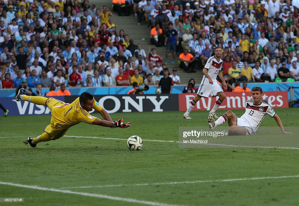 Sergio Romero the goalkeeper of Argentina dives to save from Thomas Muller of Germany during the 2014 World Cup final match between Germany and Argentina at The Maracana Stadium on July 13, 2014 in Rio de Janeiro, Brazil.