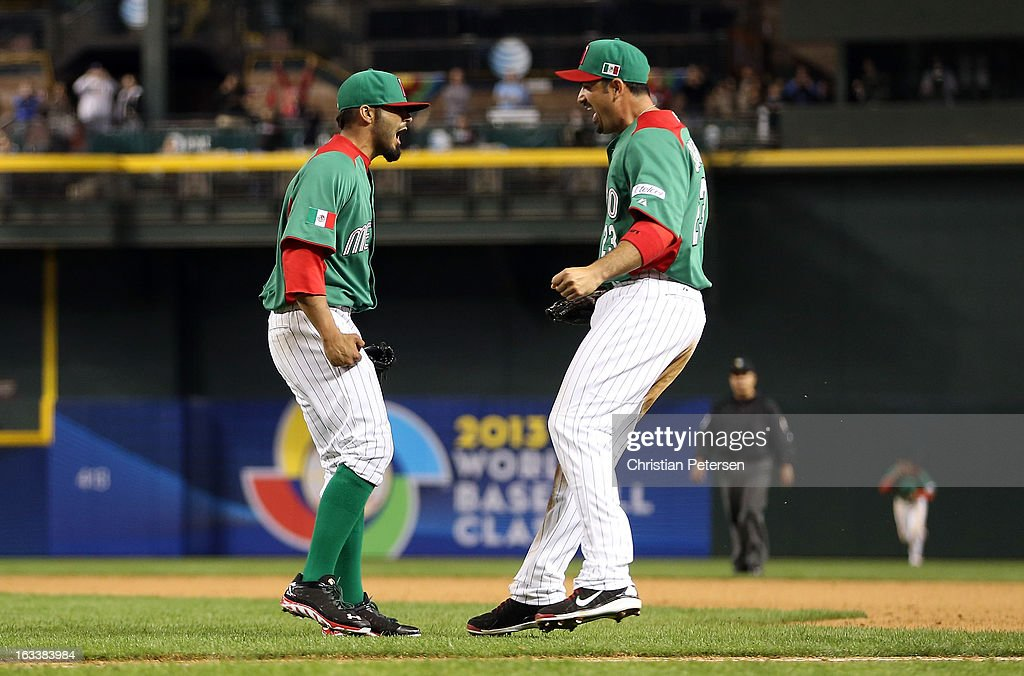 Sergio Romo #54 and Adrian Gonzalez #23 of Mexico celebrate after Mexico won 5-2 against the United States during the World Baseball Classic First Round Group D game at Chase Field on March 8, 2013 in Phoenix, Arizona.