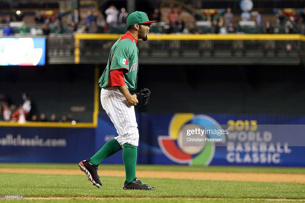 <a gi-track='captionPersonalityLinkClicked' href=/galleries/search?phrase=Sergio+Romo&family=editorial&specificpeople=5433590 ng-click='$event.stopPropagation()'>Sergio Romo</a> #54 of Mexico celebrates after Mexico won 5-2 against the United States during the World Baseball Classic First Round Group D game at Chase Field on March 8, 2013 in Phoenix, Arizona.