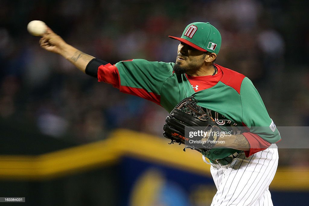 <a gi-track='captionPersonalityLinkClicked' href=/galleries/search?phrase=Sergio+Romo&family=editorial&specificpeople=5433590 ng-click='$event.stopPropagation()'>Sergio Romo</a> #54 of Mexico throws a pitch against the United States during the World Baseball Classic First Round Group D game at Chase Field on March 8, 2013 in Phoenix, Arizona.