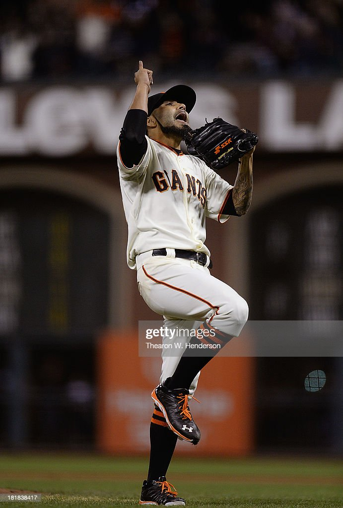 <a gi-track='captionPersonalityLinkClicked' href=/galleries/search?phrase=Sergio+Romo&family=editorial&specificpeople=5433590 ng-click='$event.stopPropagation()'>Sergio Romo</a> #54 of the San Francisco Giants celebrate defeating the Los Angeles Dodgers 6-4 at AT&T Park on September 25, 2013 in San Francisco, California.