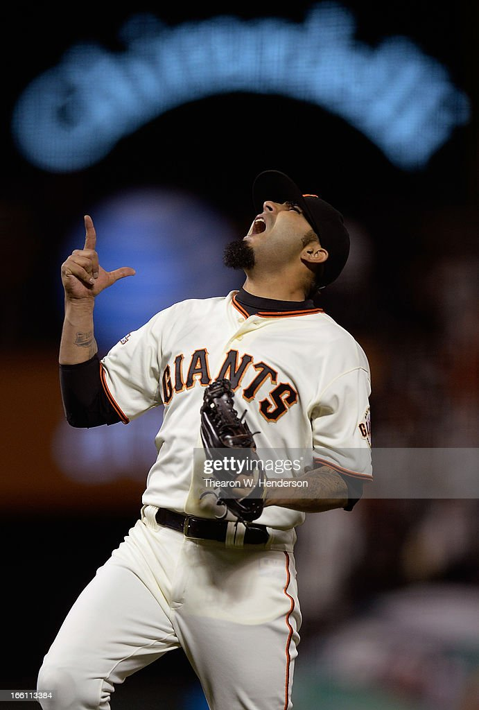 Sergio Romo #54 of the San Francisco Giants celebrates after striking out Rosario Wilin of the Colorado Rockies to end the game for a 4-2 win at AT&T Park on April 8, 2013 in San Francisco, California.