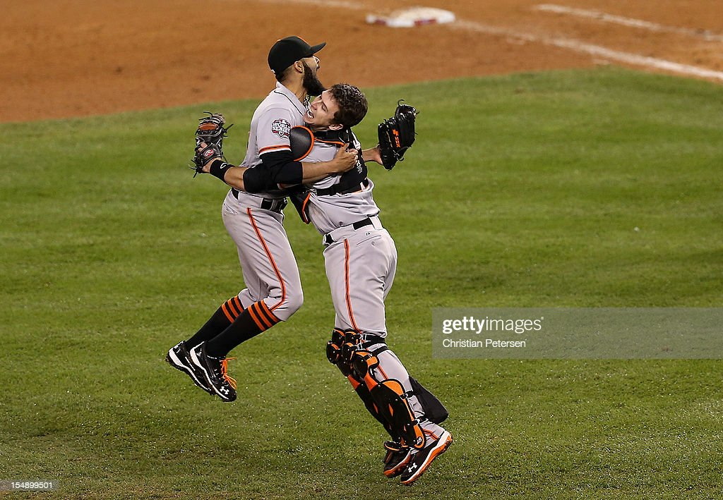 <a gi-track='captionPersonalityLinkClicked' href=/galleries/search?phrase=Sergio+Romo&family=editorial&specificpeople=5433590 ng-click='$event.stopPropagation()'>Sergio Romo</a> #54 of the San Francisco Giants celebrates with <a gi-track='captionPersonalityLinkClicked' href=/galleries/search?phrase=Buster+Posey&family=editorial&specificpeople=4896435 ng-click='$event.stopPropagation()'>Buster Posey</a> #28 after striking out Miguel Cabrera #24 of the Detroit Tigers in the tenth inning to win Game Four of the Major League Baseball World Series at Comerica Park on October 28, 2012 in Detroit, Michigan. The San Francisco Giants defeated the Detroit Tigers 4-3 in the tenth inning to win the World Series in 4 straight games.