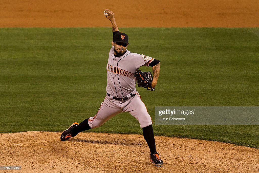 <a gi-track='captionPersonalityLinkClicked' href=/galleries/search?phrase=Sergio+Romo&family=editorial&specificpeople=5433590 ng-click='$event.stopPropagation()'>Sergio Romo</a> #54 of the San Francisco Giants delivers to home plate during the ninth inning against the Colorado Rockies at Coors Field on August 27, 2013 in Denver, Colorado. The Giants defeated the Rockies 5-3.
