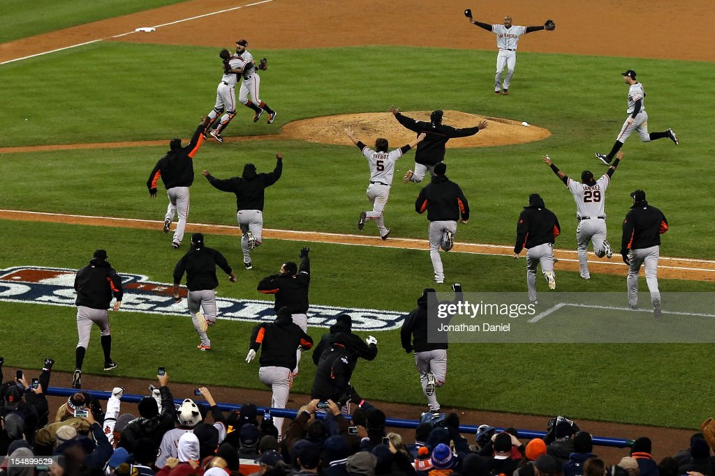 <a gi-track='captionPersonalityLinkClicked' href=/galleries/search?phrase=Sergio+Romo&family=editorial&specificpeople=5433590 ng-click='$event.stopPropagation()'>Sergio Romo</a> #54 of the San Francisco Giants hugs <a gi-track='captionPersonalityLinkClicked' href=/galleries/search?phrase=Buster+Posey&family=editorial&specificpeople=4896435 ng-click='$event.stopPropagation()'>Buster Posey</a> #28 and teammates after striking out Miguel Cabrera #24 of the Detroit Tigers in the tenth inning to win Game Four of the Major League Baseball World Series at Comerica Park on October 28, 2012 in Detroit, Michigan. The San Francisco Giants defeated the Detroit Tigers 4-3 in the tenth inning to win the World Series in 4 straight games.