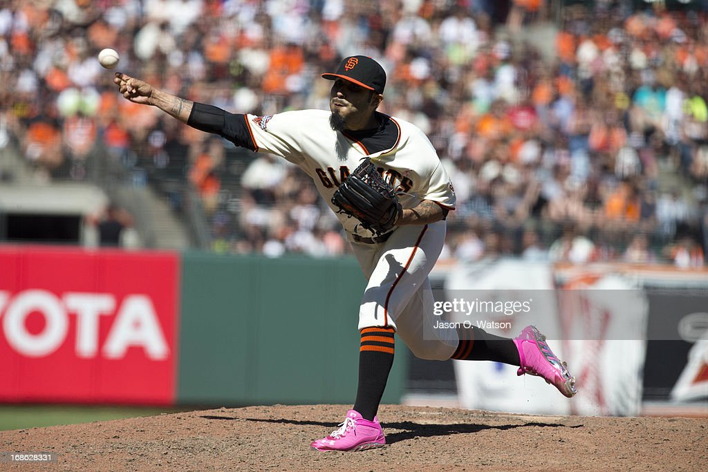 <a gi-track='captionPersonalityLinkClicked' href=/galleries/search?phrase=Sergio+Romo&family=editorial&specificpeople=5433590 ng-click='$event.stopPropagation()'>Sergio Romo</a> #54 of the San Francisco Giants pitches against the Atlanta Braves during the ninth inning at AT&T Park on May 12, 2013 in San Francisco, California. The San Francisco Giants defeated the Atlanta Braves 5-1.