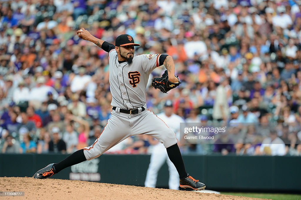 <a gi-track='captionPersonalityLinkClicked' href=/galleries/search?phrase=Sergio+Romo&family=editorial&specificpeople=5433590 ng-click='$event.stopPropagation()'>Sergio Romo</a> #54 of the San Francisco Giants pitches against the Colorado Rockies during the game at Coors Field on June 30, 2013 in Denver, Colorado.