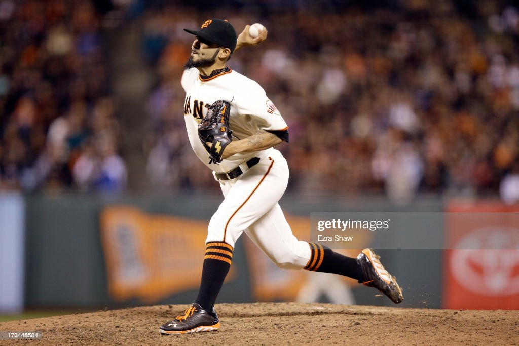 <a gi-track='captionPersonalityLinkClicked' href=/galleries/search?phrase=Sergio+Romo&family=editorial&specificpeople=5433590 ng-click='$event.stopPropagation()'>Sergio Romo</a> #54 of the San Francisco Giants pitches against the New York Mets at AT&T Park on July 8, 2013 in San Francisco, California.