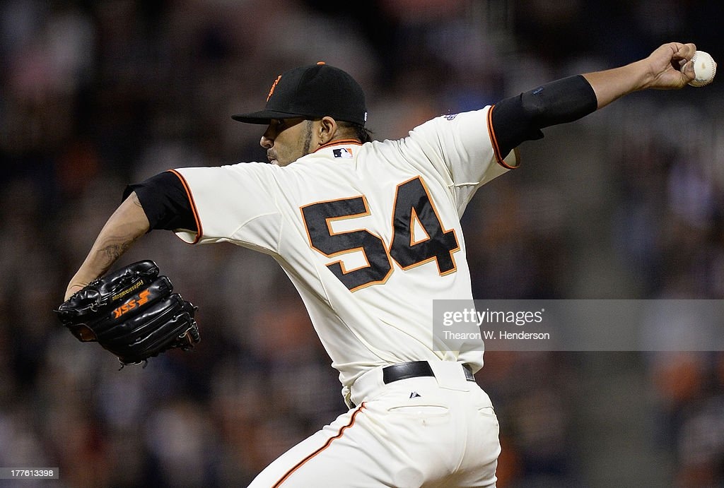 <a gi-track='captionPersonalityLinkClicked' href=/galleries/search?phrase=Sergio+Romo&family=editorial&specificpeople=5433590 ng-click='$event.stopPropagation()'>Sergio Romo</a> #54 of the San Francisco Giants pitches in the ninth inning against the Pittsburgh Pirates at AT&T Park on August 24, 2013 in San Francisco, California. The Giants won the game 6-3.