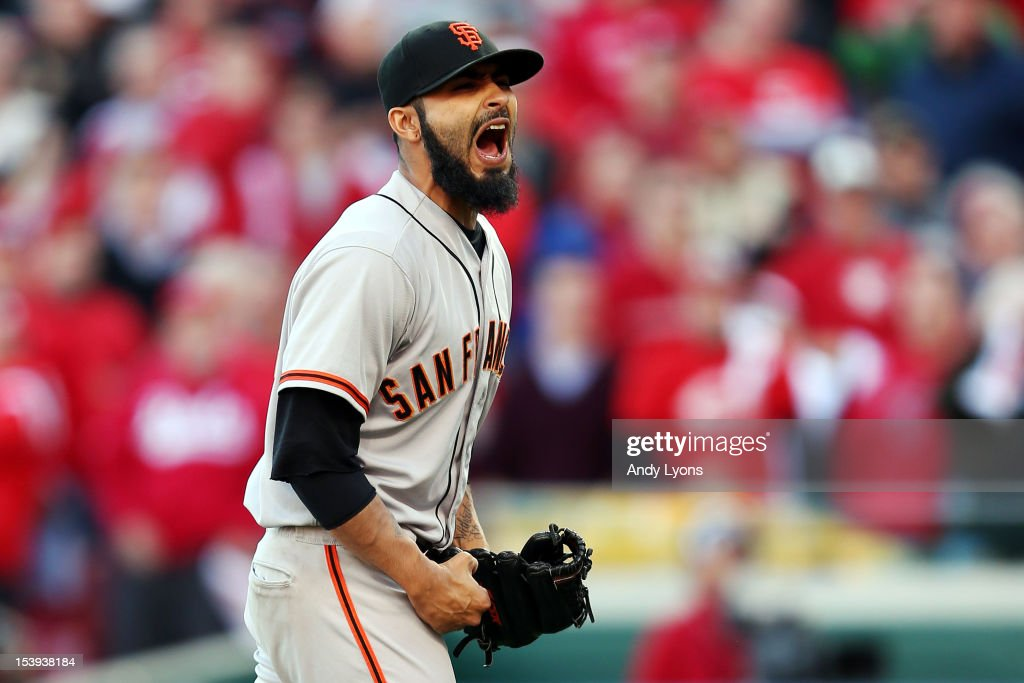<a gi-track='captionPersonalityLinkClicked' href=/galleries/search?phrase=Sergio+Romo&family=editorial&specificpeople=5433590 ng-click='$event.stopPropagation()'>Sergio Romo</a> #54 of the San Francisco Giants reacts after defeating the Cincinnati Reds by a score of 6-4 to win Game Five of the National League Division Series and advance to the NLCS at Great American Ball Park on October 11, 2012 in Cincinnati, Ohio.
