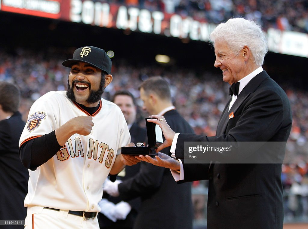 <a gi-track='captionPersonalityLinkClicked' href=/galleries/search?phrase=Sergio+Romo&family=editorial&specificpeople=5433590 ng-click='$event.stopPropagation()'>Sergio Romo</a> #54 of the San Francisco Giants reacts as he receives his World Series ring from Giants owner Bill Neukom before the start of the game against the St. Louis Cardinals at AT&T Park on April 9, 2011 in San Francisco, California.