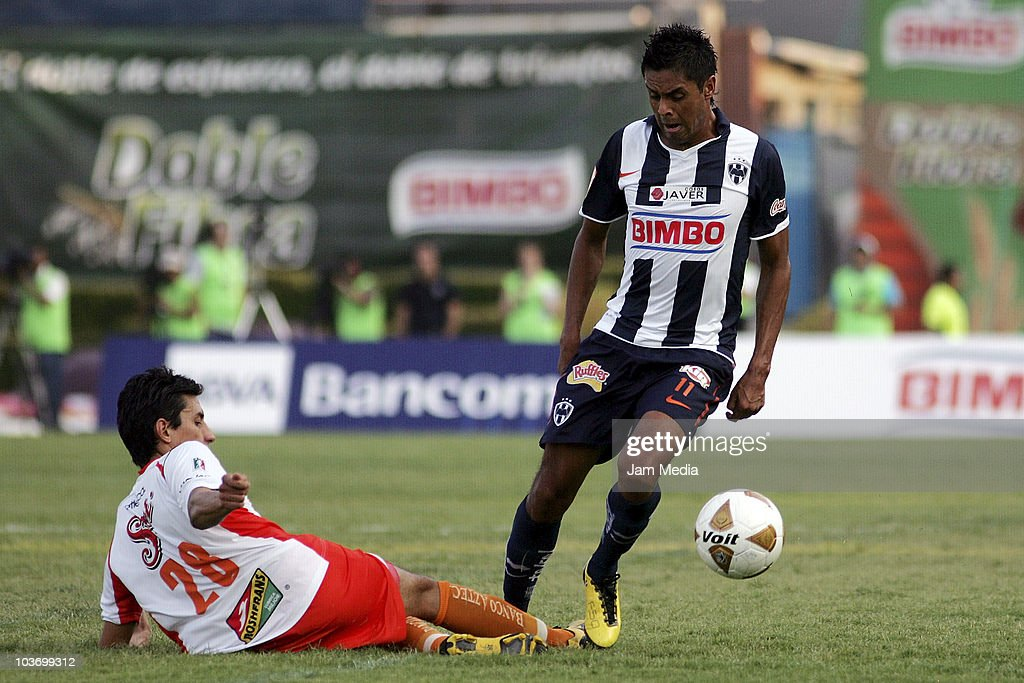 Sergio Santana (R) of Monterrey struggles for the ball with Marvin Cabrera (L) of Jaguares during a match as part of the Apertura 2010 at Tecnologico Stadium on August 28, 2010 in Monterrey, Mexico.