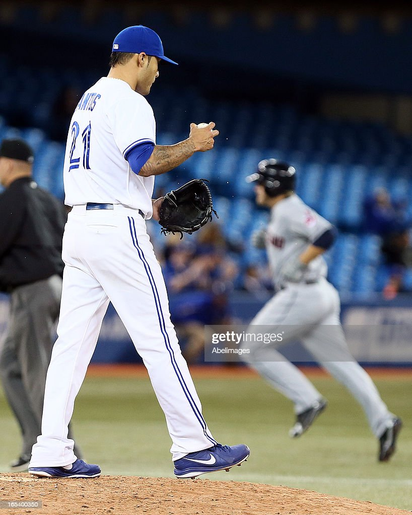 Sergio Santos #21 of the Toronto Blue Jays looks on as <a gi-track='captionPersonalityLinkClicked' href=/galleries/search?phrase=Mark+Reynolds+-+Baseball+Player&family=editorial&specificpeople=2343799 ng-click='$event.stopPropagation()'>Mark Reynolds</a> #12 of the Cleveland Indians rounds the bases after hitting a home rung in the 11th inning to take the lead during MLB action at the Rogers Centre April 3, 2013 in Toronto, Ontario, Canada.