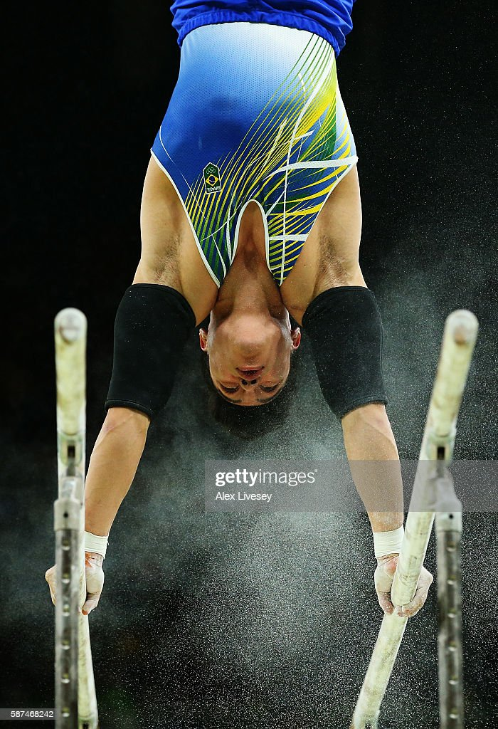 Sergio Sasaki of Brazil competes on the parallel bars during the men's team final on Day 3 of the Rio 2016 Olympic Games at the Rio Olympic Arena on August 8, 2016 in Rio de Janeiro, Brazil.