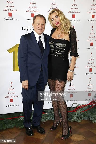 Sergio Valente and Valeria Marini attend the 'Il Natale Dei 100 Alberi d'Autore 100 Christmas Trees By Designers' benefit night at Palazzo Torlonia...