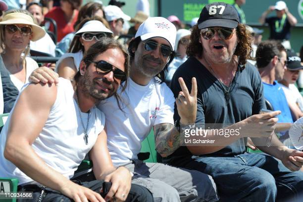 Sergio Vallin Alex Gonzalez and Fher Olvera of rock band Mana attend Sony Ericsson Open at Crandon Park Tennis Center on March 26 2011 in Key...