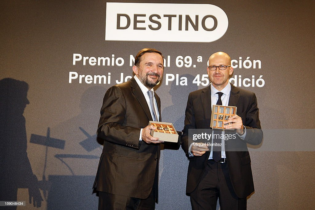 Sergio Vilasanjuan (L) wins the 69th Nadal literature award' with his 'Estaba en el aire', 'It was on the air' and Genis Sinca (R) wins the 45th 'Josep Pla literature award' with his 'Una familia exemplar', 'An exemplary family' pose on stage on January 6, 2013 in Barcelona, Spain.