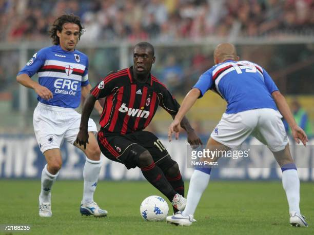 Sergio Volpi and Giulio Falcone of Sampdoria competes with Clarence Seedorf of Milan during the Serie A match between Sampdoria and AC Milan at Luigi...