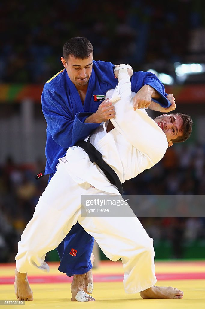 Sergiu Toma of United Arab Emirates and Victor Penalber of Brazil compete during the Men's 81kg bout on Day 4 of the Rio 2016 Olympic Games at the...