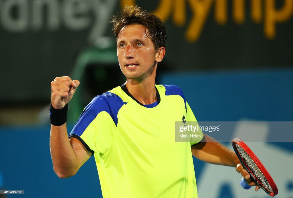 <a gi-track='captionPersonalityLinkClicked' href=/galleries/search?phrase=Sergiy+Stakhovsky&family=editorial&specificpeople=579263 ng-click='$event.stopPropagation()'>Sergiy Stakhovsky</a> of the Ukraine celebrates winning his match against Marinko Matosevic of Australia during day five of the 2014 Sydney International at Sydney Olympic Park Tennis Centre on January 9, 2014 in Sydney, Australia.