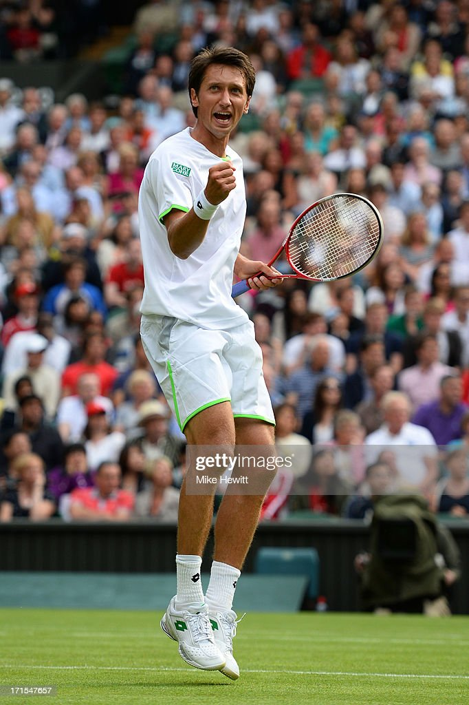 <a gi-track='captionPersonalityLinkClicked' href=/galleries/search?phrase=Sergiy+Stakhovsky&family=editorial&specificpeople=579263 ng-click='$event.stopPropagation()'>Sergiy Stakhovsky</a> of Ukraine celebrates a point during his Gentlemen's Singles second round match against Roger Federer of Switzerland on day three of the Wimbledon Lawn Tennis Championships at the All England Lawn Tennis and Croquet Club on June 26, 2013 in London, England.