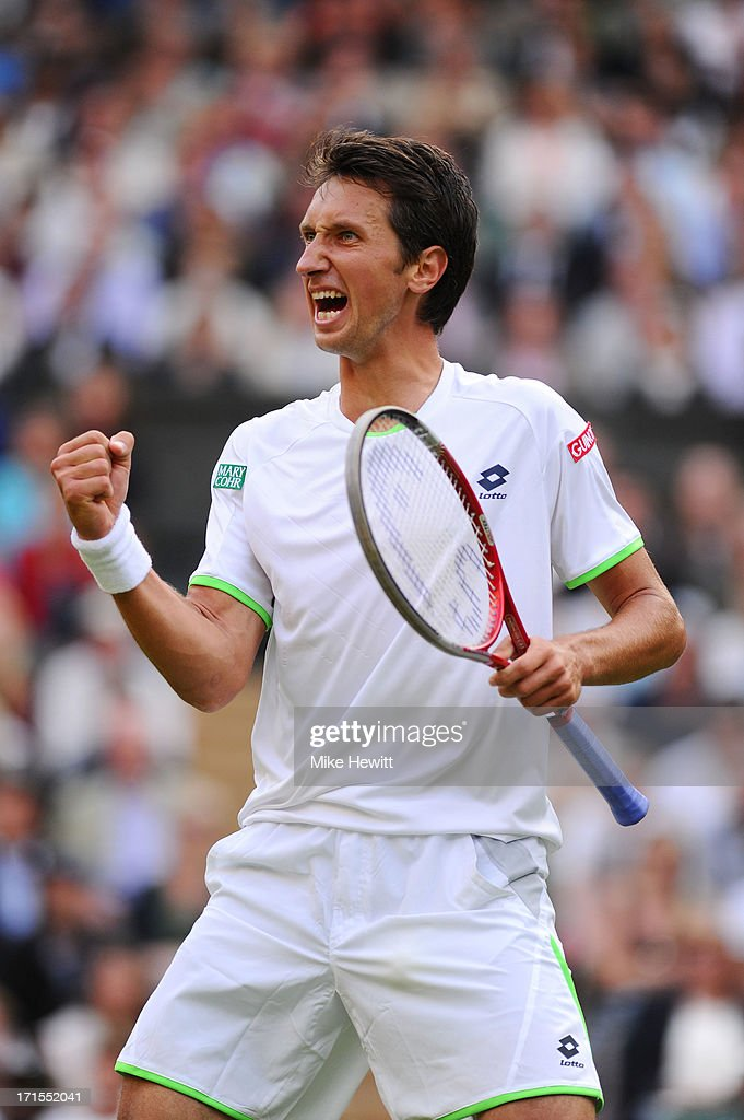 <a gi-track='captionPersonalityLinkClicked' href=/galleries/search?phrase=Sergiy+Stakhovsky&family=editorial&specificpeople=579263 ng-click='$event.stopPropagation()'>Sergiy Stakhovsky</a> of Ukraine celebrates match point during his Gentlemen's Singles second round match against Roger Federer of Switzerland on day three of the Wimbledon Lawn Tennis Championships at the All England Lawn Tennis and Croquet Club on June 26, 2013 in London, England.