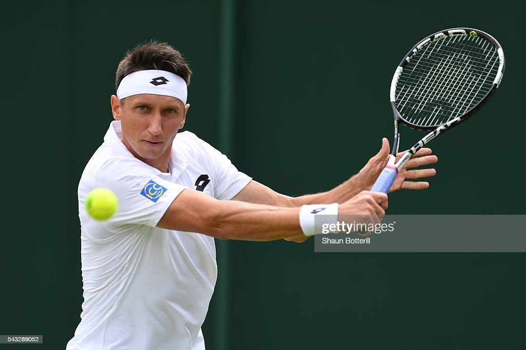 Sergiy Stakhovsky of Ukraine plays a backhand shot during the Men's Singles first round match against <a gi-track='captionPersonalityLinkClicked' href=/galleries/search?phrase=Yoshihito+Nishioka&family=editorial&specificpeople=9451757 ng-click='$event.stopPropagation()'>Yoshihito Nishioka</a> of Japan on day one of the Wimbledon Lawn Tennis Championships at the All England Lawn Tennis and Croquet Club on June 27th, 2016 in London, England.