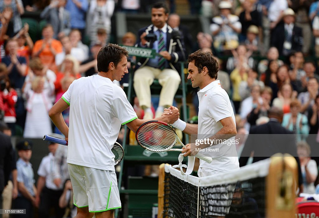 <a gi-track='captionPersonalityLinkClicked' href=/galleries/search?phrase=Sergiy+Stakhovsky&family=editorial&specificpeople=579263 ng-click='$event.stopPropagation()'>Sergiy Stakhovsky</a> of Ukraine shakes hands at the net with <a gi-track='captionPersonalityLinkClicked' href=/galleries/search?phrase=Roger+Federer&family=editorial&specificpeople=157480 ng-click='$event.stopPropagation()'>Roger Federer</a> of Switzerland after their Gentlemen's Singles second round match on day three of the Wimbledon Lawn Tennis Championships at the All England Lawn Tennis and Croquet Club on June 26, 2013 in London, England.