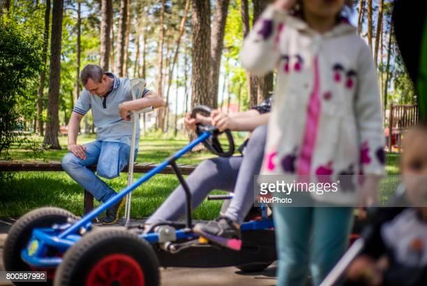 Sergiy Tarasiuk ATO veteran spends time in the park near his home in Irpin Kyiv region Ukraine Sergiy Tarasiuk lost his left leg in 2014 after 3...